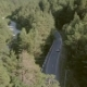 Beautiful View From Above Car Moving Along Road Among Green Forest To Mountains - VideoHive Item for Sale