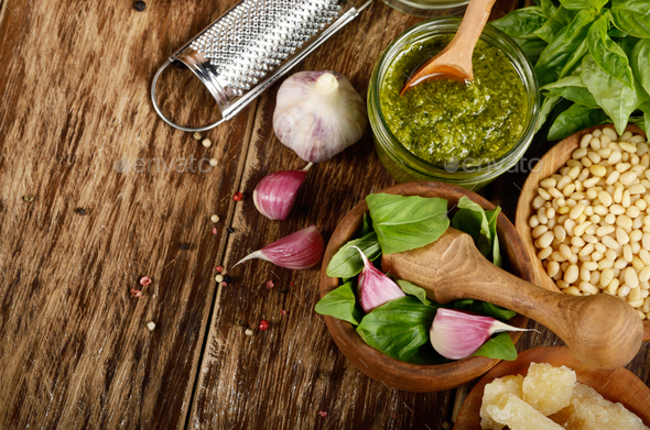Top view of Pesto sauce ingredients and utensils on wood table - Stock Photo - Images