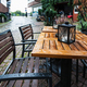 empty wooden wet table in outdoor cafe - PhotoDune Item for Sale