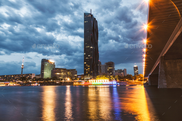 Vienna skyline on the Danube river at night - Stock Photo - Images