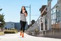 City workout. Beautiful woman running in an urban setting