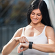 City workout. Beautiful woman with a smartwatch training in an urban setting - PhotoDune Item for Sale