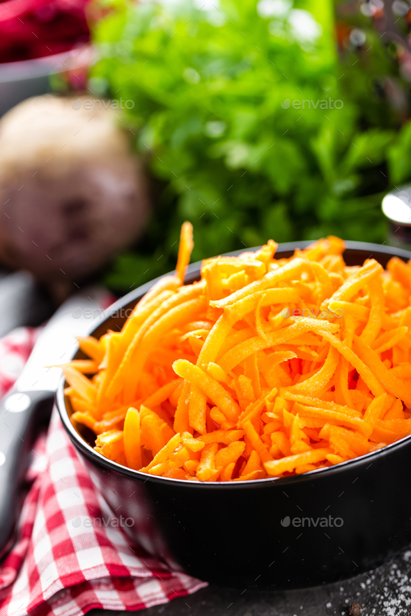 Fresh grated carrot - Stock Photo - Images