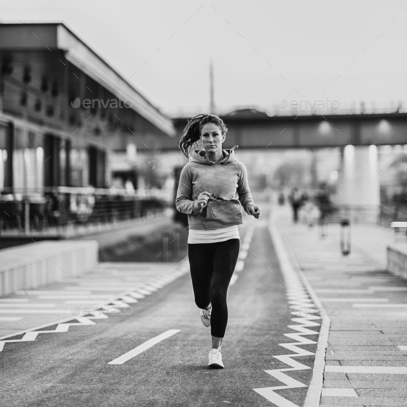 Woman jogging on riverside - Stock Photo - Images