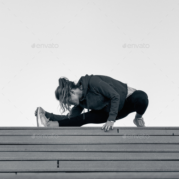 Streching on stairs - Stock Photo - Images
