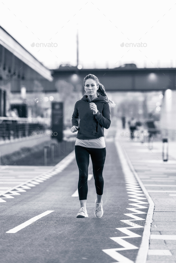 Woman jogging in the city - Stock Photo - Images