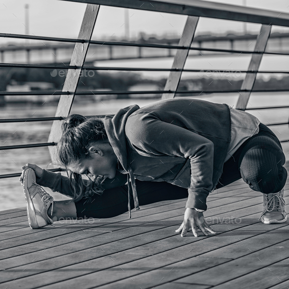 Streching by the riverside - Stock Photo - Images