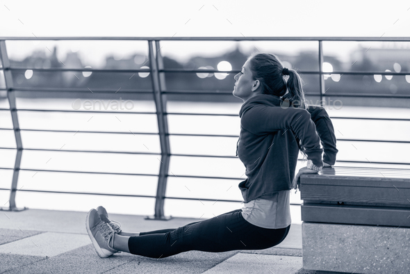 Woman exercising in the city - Stock Photo - Images