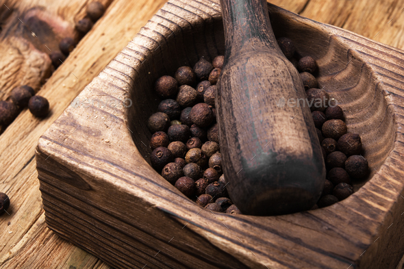 peppercorn in retro wooden mortar - Stock Photo - Images