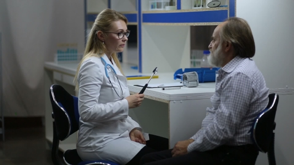 Doctor Inspecting A Patient