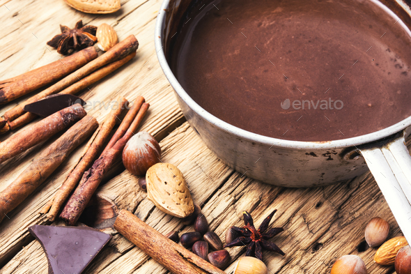 Melting chocolate in a metal bowl - Stock Photo - Images