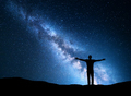 Night landscape with Milky Way and silhouette of a man - PhotoDune Item for Sale
