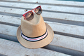 Sunglasses and hat on the wooden texture in summer - PhotoDune Item for Sale