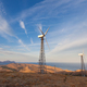 Wind turbine generating electricity in mountains at sunset - PhotoDune Item for Sale