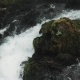 Small Waterfall Flowing Down The Rocks, Mountain River Raging Among The Rocks In The Forest - VideoHive Item for Sale
