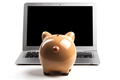 Piggy Bank With Laptop