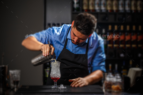 Bartender pouring fresh cocktail - Stock Photo - Images