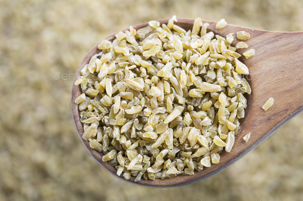 Freekeh in Wooden Spoon - Stock Photo - Images