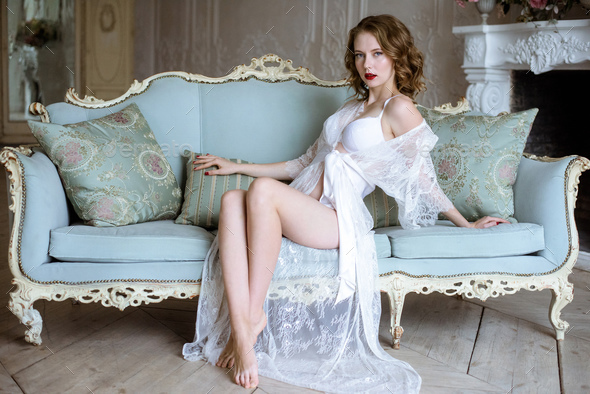 Beautiful sexy lady in elegant white robe - Stock Photo - Images