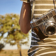 Tourist with vintage camera in the countryside. Travel background. Lifestyle - PhotoDune Item for Sale