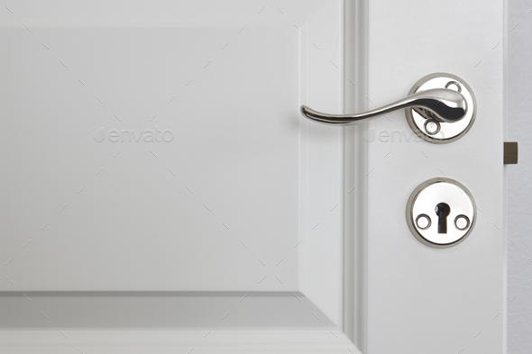 Metallic door knob on a classic white door. Home interior - Stock Photo - Images