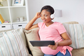 pregnant woman in headphones with tablet pc - PhotoDune Item for Sale