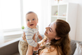 happy young mother with little baby at home - PhotoDune Item for Sale