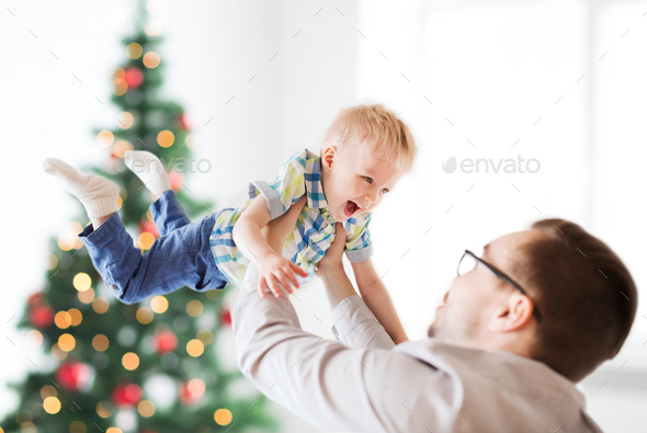 happy father playing with son at christmas - Stock Photo - Images