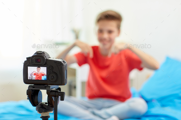 camera recording video of blogger boy at home - Stock Photo - Images