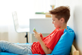 happy smiling boy with smartphone at home - PhotoDune Item for Sale
