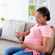 happy pregnant woman with tablet pc at home - PhotoDune Item for Sale