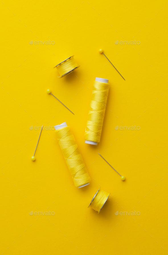 Yellow thread spools - Stock Photo - Images