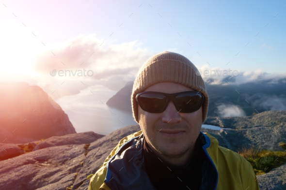 Traveler portrait on Lysefjorden fjord - Stock Photo - Images