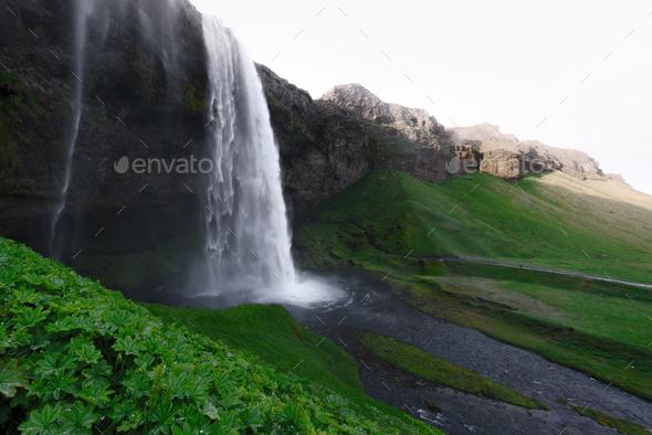 Sunrise on Seljalandfoss waterfall - Stock Photo - Images