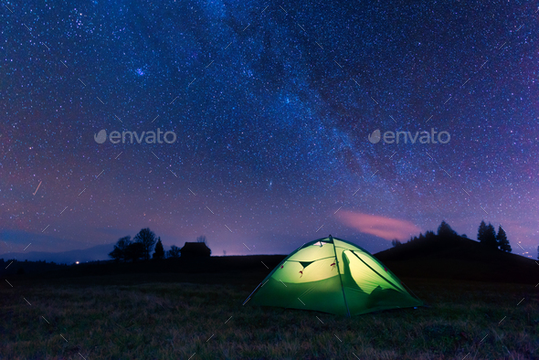 Green tent lighted from the inside - Stock Photo - Images