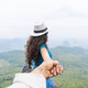 Man Hold Woman Hand, Tourist Couple With Backpack On Mountain Top Back Rear View Enjoy Beautiful - PhotoDune Item for Sale