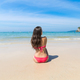 Attractive Young Caucasian Woman In Swimsuit Sitting On Beach Back Rear View, Girl Blue Sea Water - PhotoDune Item for Sale
