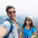 Couple With Backpacks Take Selfie Photo Over Mountain Landscape Trekking, Young Man And Woman On - PhotoDune Item for Sale