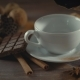 Cup of Hot Chocolate, Cinnamon Sticks, Cookies and Chocolate on Wooden Table - VideoHive Item for Sale