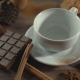 Cup of Hot Chocolate, Cinnamon Sticks and Chocolate on Wooden Table - VideoHive Item for Sale