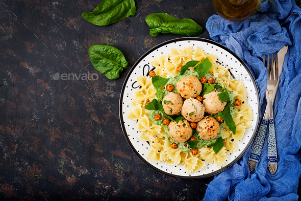 Farfalle pasta with meatballs and spinach  sauce with fried chickpeas - Stock Photo - Images