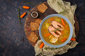 Salmon fish soup with vegetables in bowl. Flat lay. Top view
