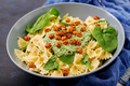 Vegan Farfalle pasta with spinach  sauce with fried chickpeas.