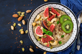 Delicious and healthy oatmeal with figs, nuts, kiwi and seeds.  - PhotoDune Item for Sale