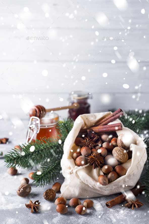 Fresh whole nuts and spices spilling - Stock Photo - Images