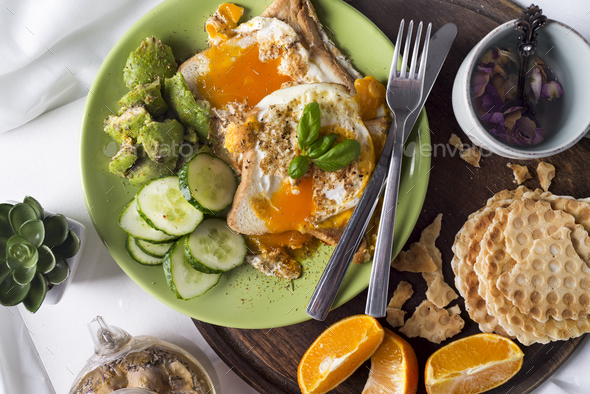 Fried eggs with toasts and tea in bed - Stock Photo - Images