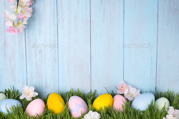 decorated easter eggs in the grass - Stock Photo - Images