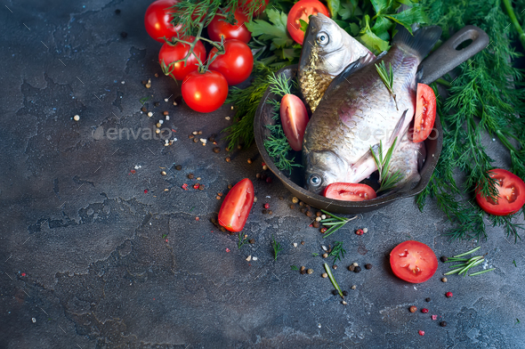 Delicious fresh fish on dark vintage background. - Stock Photo - Images