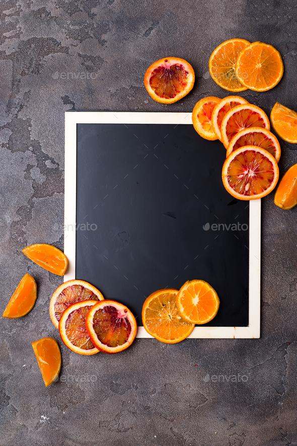 orange rings on a black chalkboard. - Stock Photo - Images