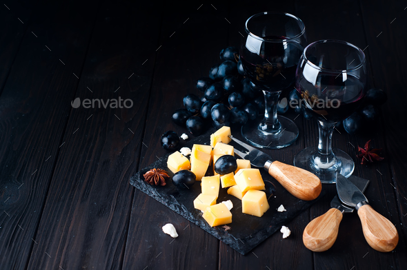 two glasses of red wine and cheese - Stock Photo - Images